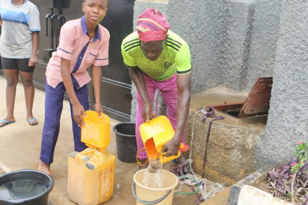 Abuja Residents Forced To Fetch Water From Streams Due To Water Scarcity (Photos) 8