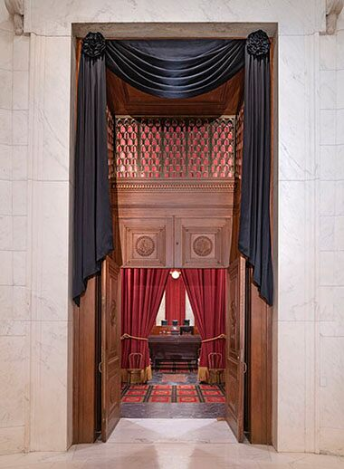 Supreme Court drapes black cloth over Ginsburg's seat: photos