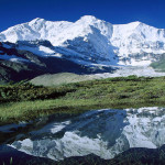CHOMOLONZO PEAK REFLECTED IN SMALL POND, KANGSHUNG GLACIER, TIBET(source: flicker)