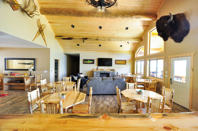 Don't let the bison on the wall frighten you! Here's a view from the bar in our west glacier lodge. These accommodations can't be beat! That's right, we said bar!