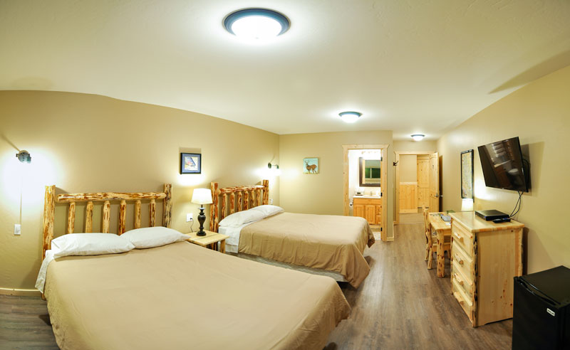 Comfortable queen beds with that Montana feel in these accommodations you sleep soundly and dream of your GNP adventures.