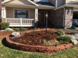 Flagstone walkways and wall with perennials and shrubs in Louisville, CO