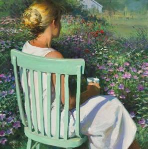 Kvinna grön stol sitter