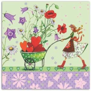 Kvinna skottkärra blommor