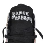 The Converse Chuck Taylor All Star Black Sabbath hi-top features album cover art from Black Sabbath's self-titled debut album Black Sabbath. The iconic art includes Mapledurham Watermill in Oxfordshire, England. The stitched Black Sabbath tongue label features the same text font as the album cover. $60
