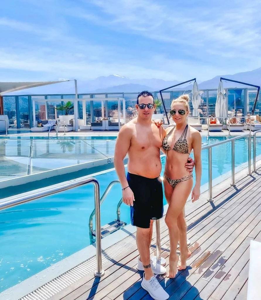 ICON hotel Santiago Chile rooftop pool couple swimwear