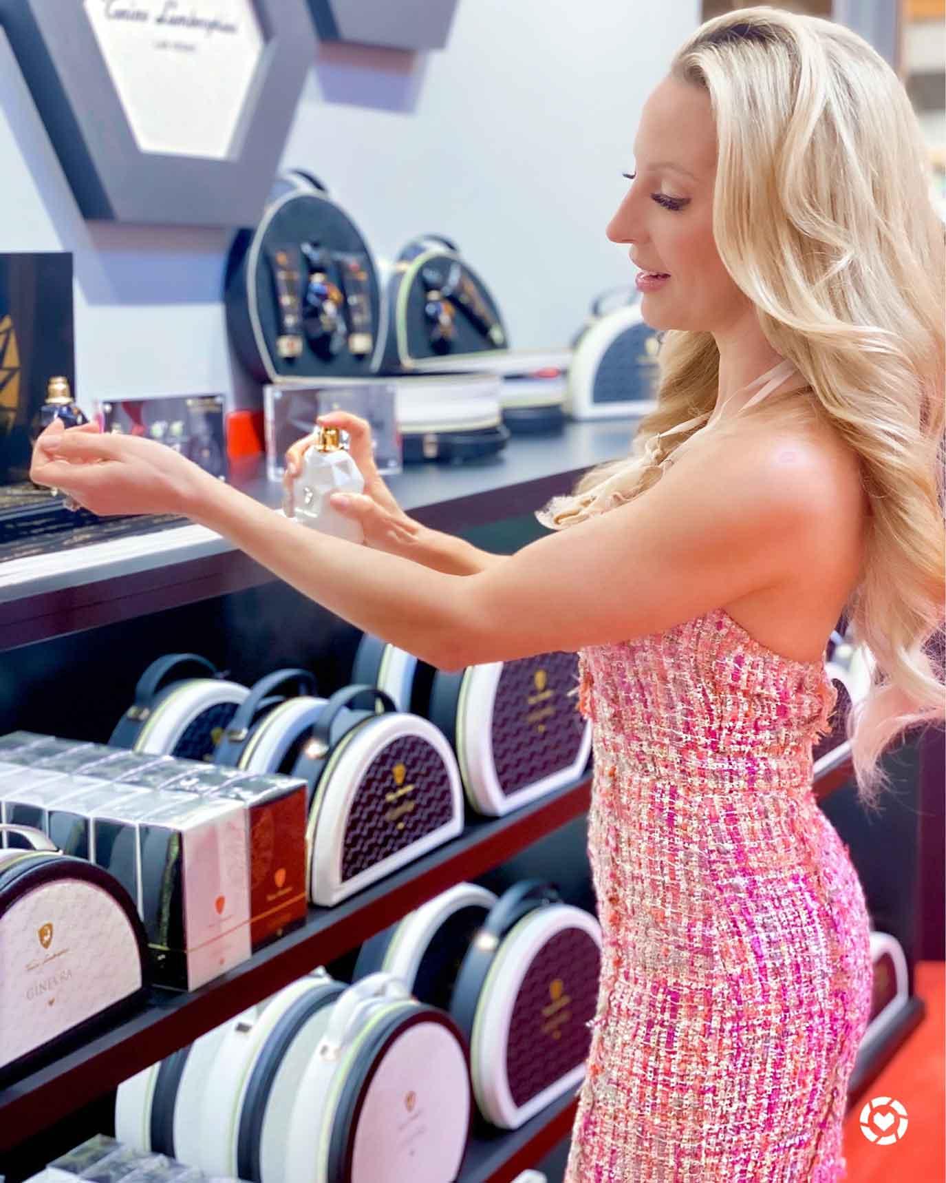 Blonde woman pink dress soft curls
