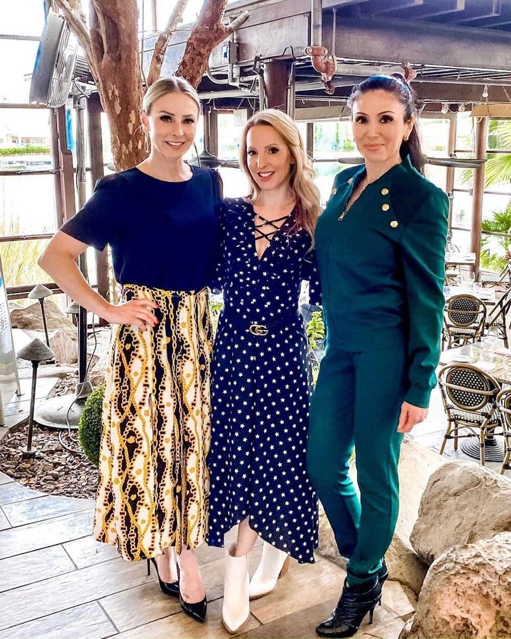 3 women fashion bloggers wearing fall boots 2021