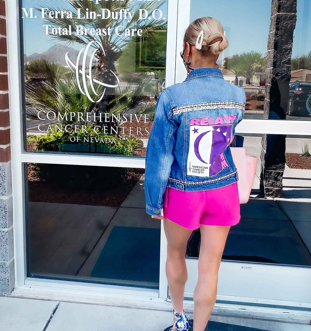 breast cancer awareness advocate entering clinic