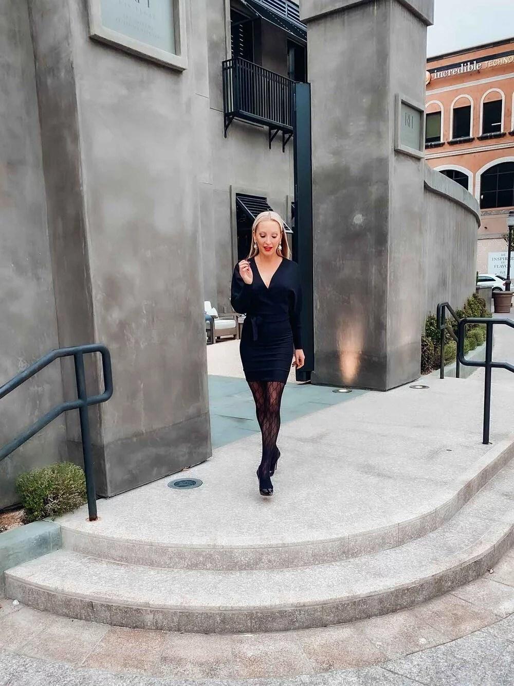 Winter fashion model walking Femme Luxe Finery black dress black gucci tights