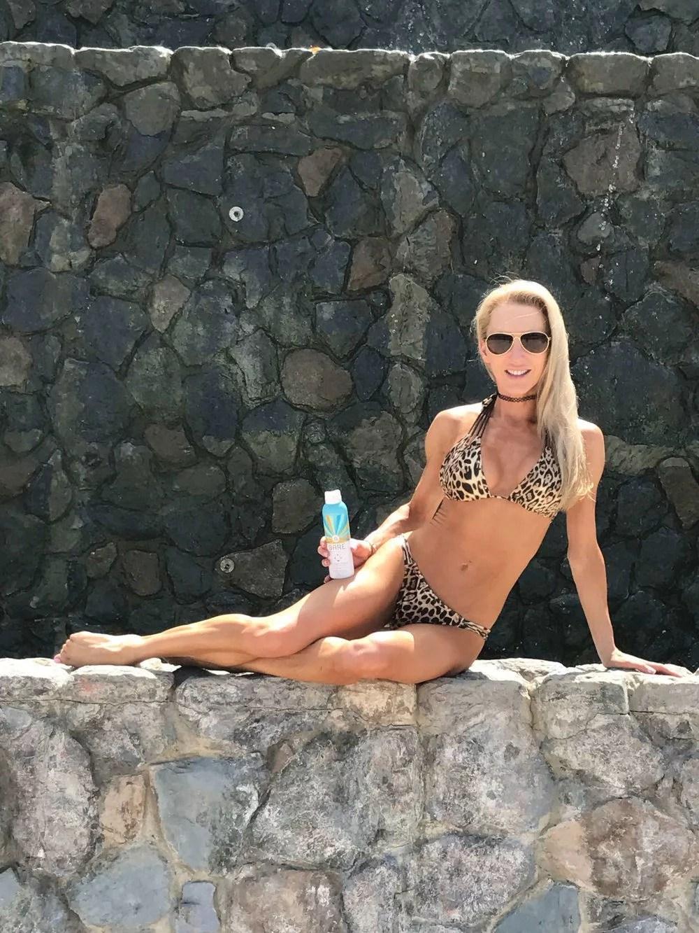 Best cruelty-free sunscreen Bare Republic Clearscreen® SPF 50 Sport Sunscreen Spray bikini model St Thomas.