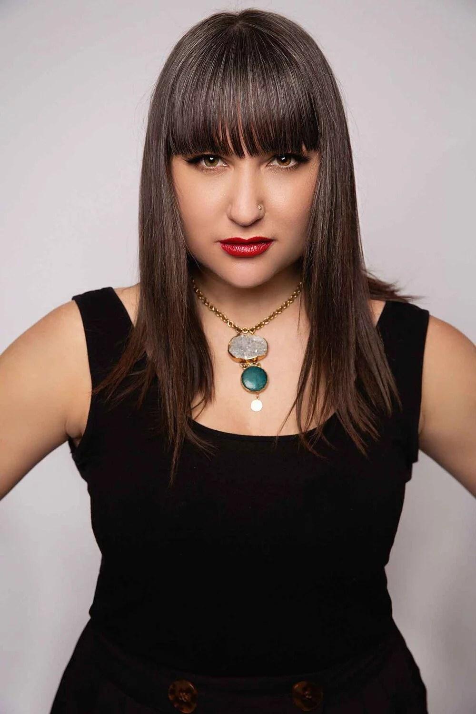 Missy MacKintosh makeup artist wearing empowering red lipstick