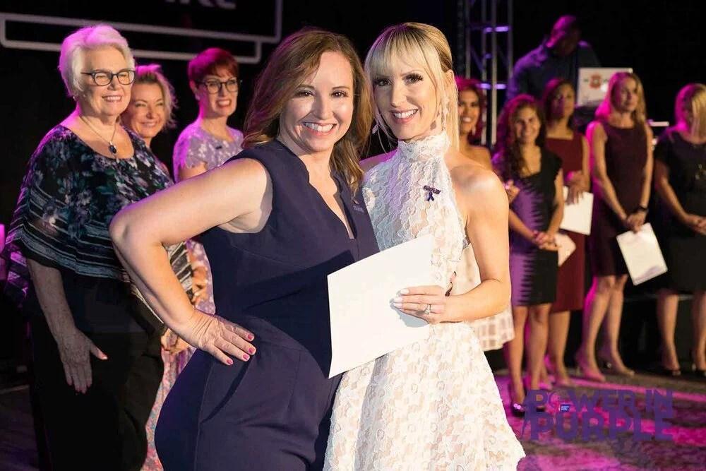 Eve Dawes receiving cancer advocacy award