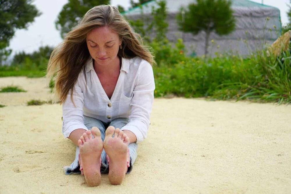 Yoga forward fold stretch with yoga instructor