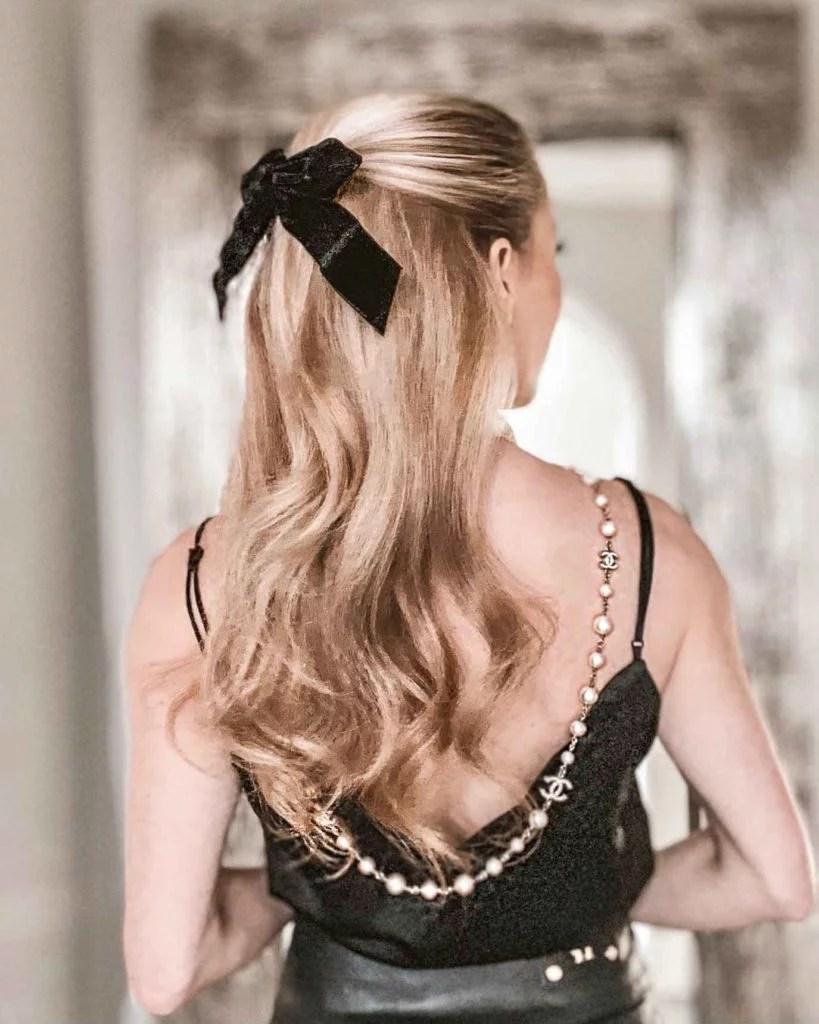 Bridgerton hair style soft curls and black bow hair accessory