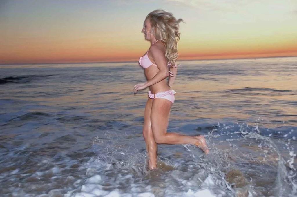 cardio exercise beach sunset Eve Dawes pink bikini