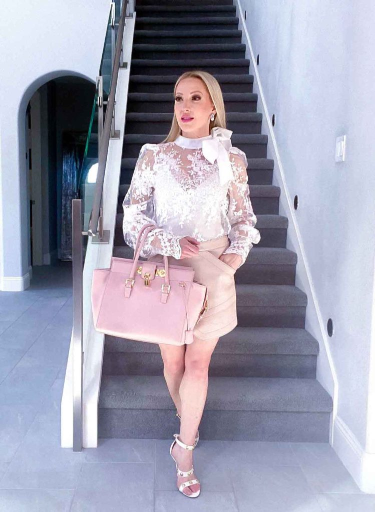 Luxury fashion blogger stairs the real real pink Versace bag