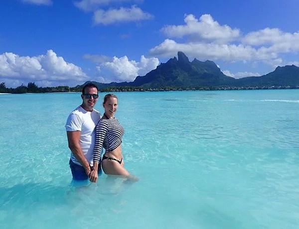 romantic couple water Bora Bora Glamour Gains luxury travel blog