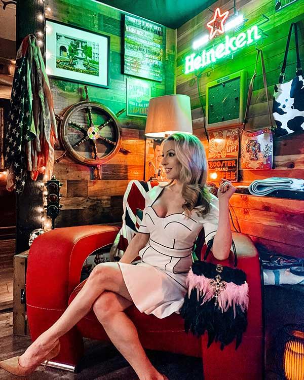 ICJUK custom old Hollywood glamour  feather bag Eve Dawes sitting red chair