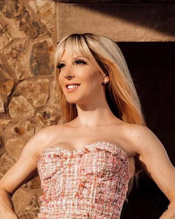 blonde clip in bangs beauty blogger Eve Dawes pink dress
