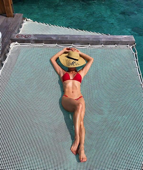 Eve Dawes sunbathing over water villa hammock Conrad Bora Bora Nui