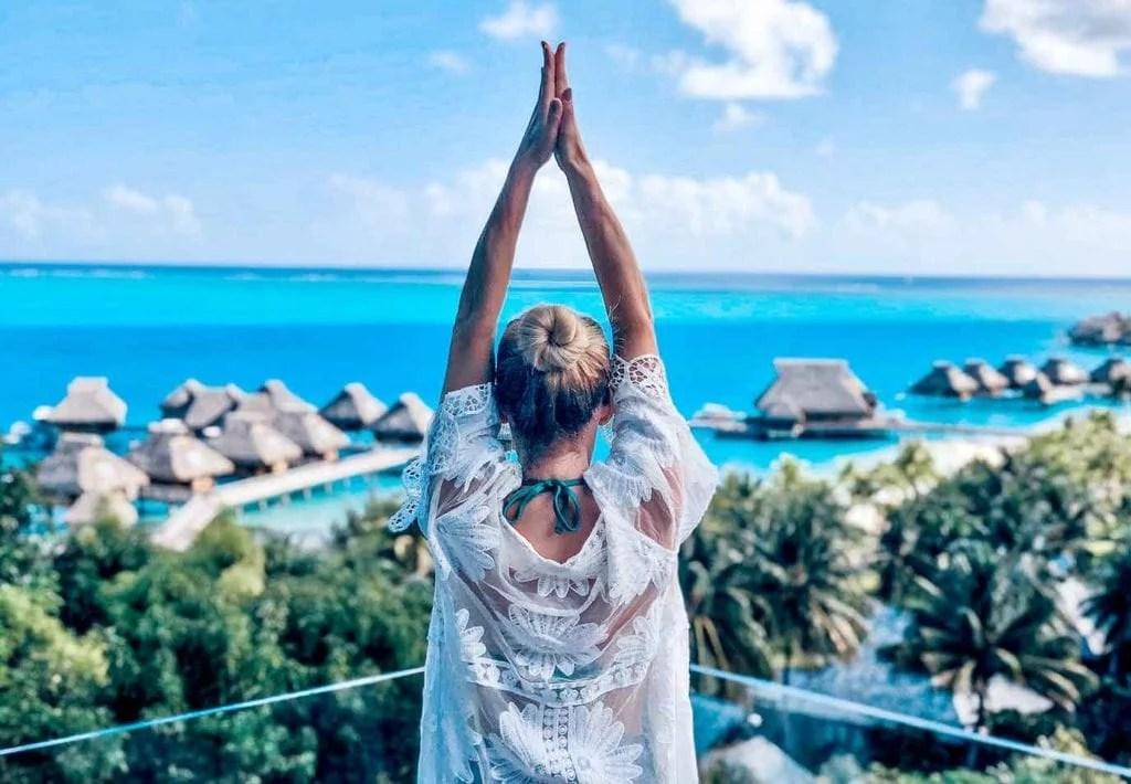 Conrad Bora Bora spa view woman yoga pose