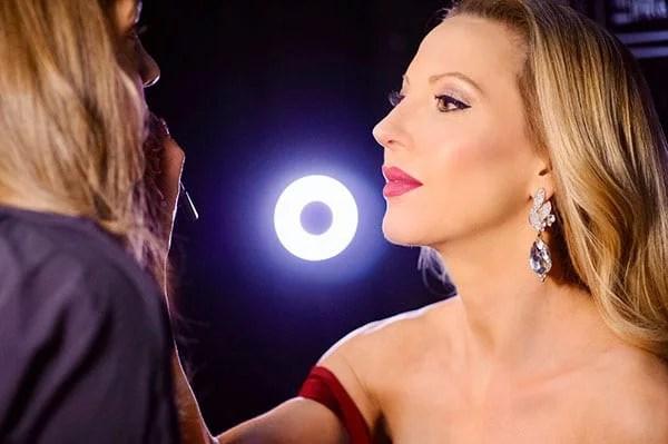 Eve Dawes applying makeup woman
