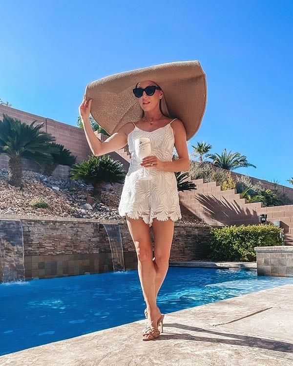 beach vacation fashion essential stylish large sun hat blogger Eve Dawes