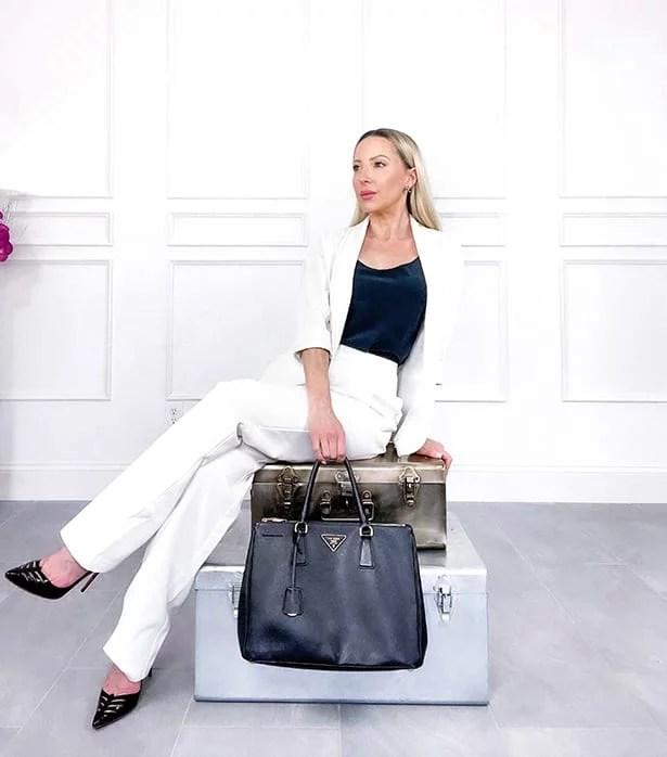 Luxury fashion blogger white suit Prada black saffiano tote