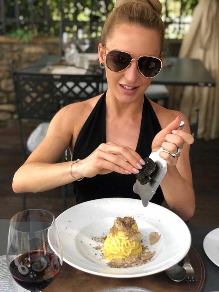 Shaving fresh truffle pasta Tuscany Italy