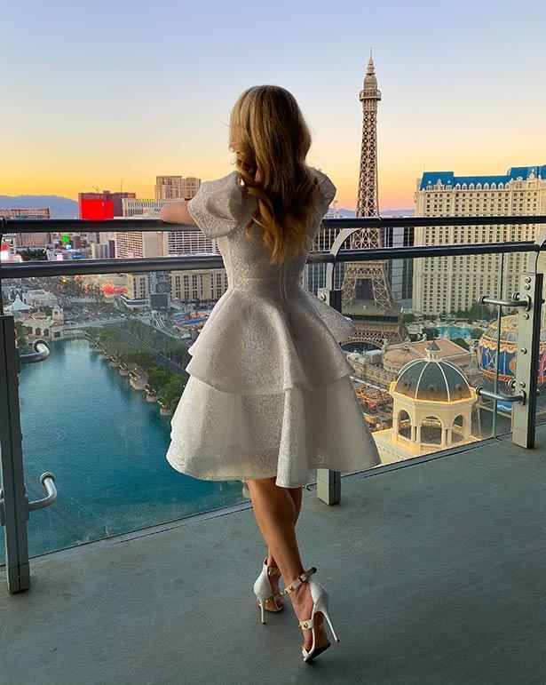 short white lace dress eve dawes Vegas balcony