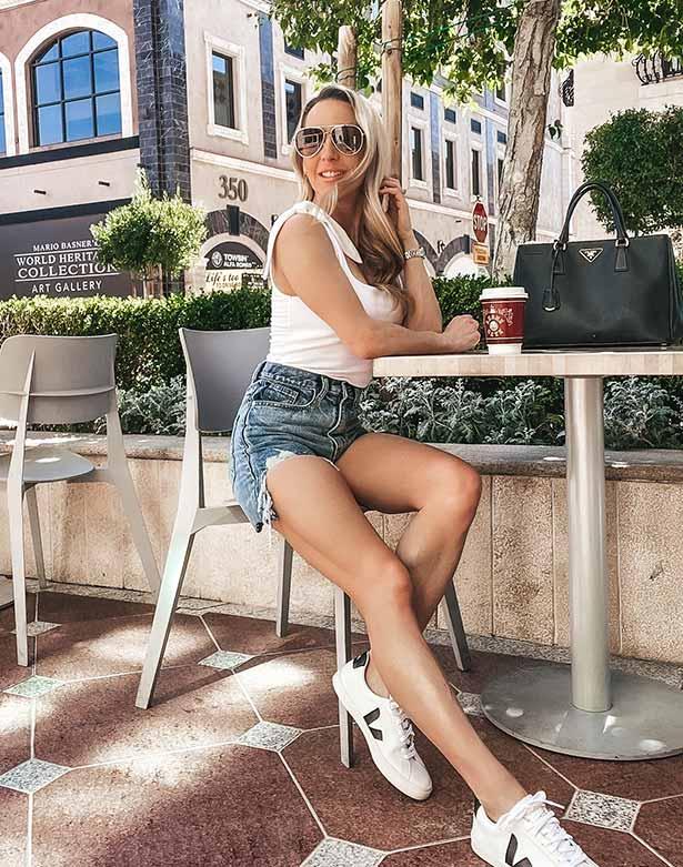 Express top woman fashion blogger sat cafe