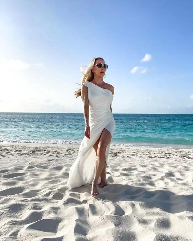 luxury travel blogger turks caicos grace bay beach white dress