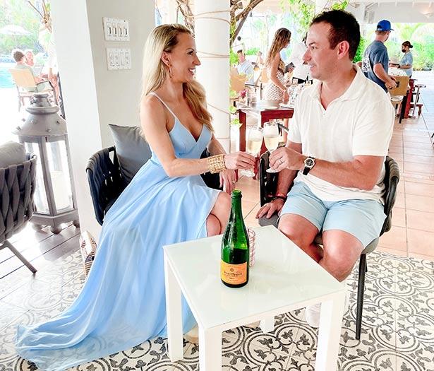 turks caicos boutique hotel romantic couple champagne