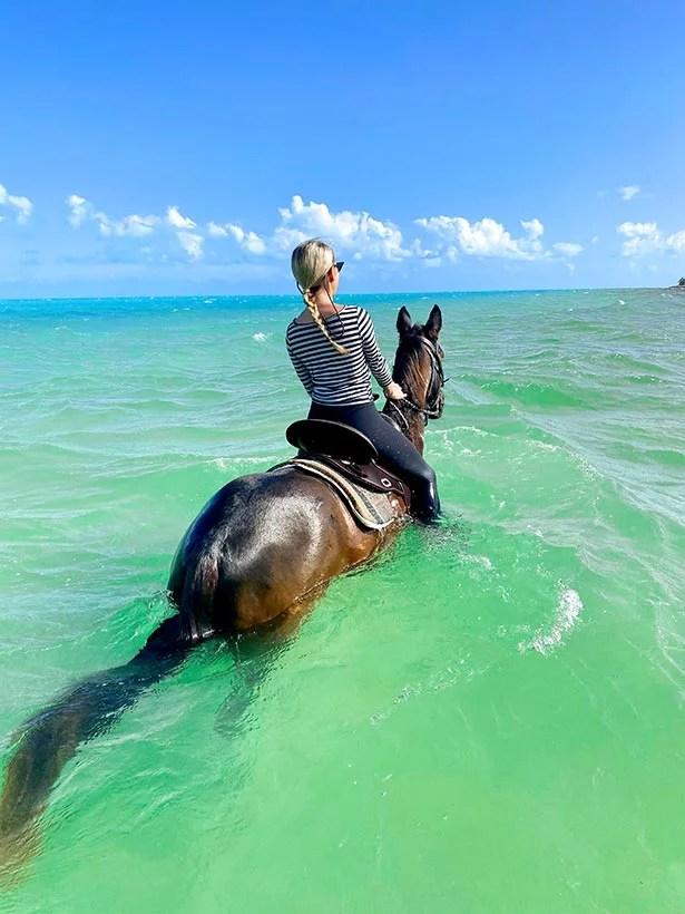 luxury travel blogger Eve Dawes horseback riding ocean Providenciales