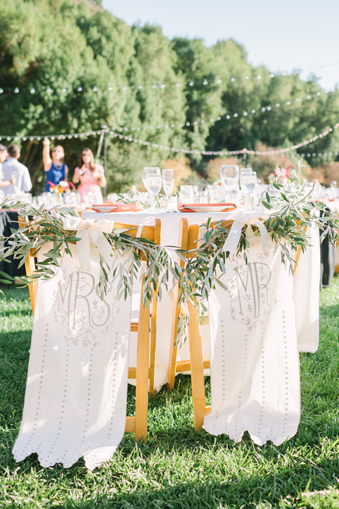 BHLDN Mr and Mrs chair covers   Kirsten Julia Photography   Glamour & Grace