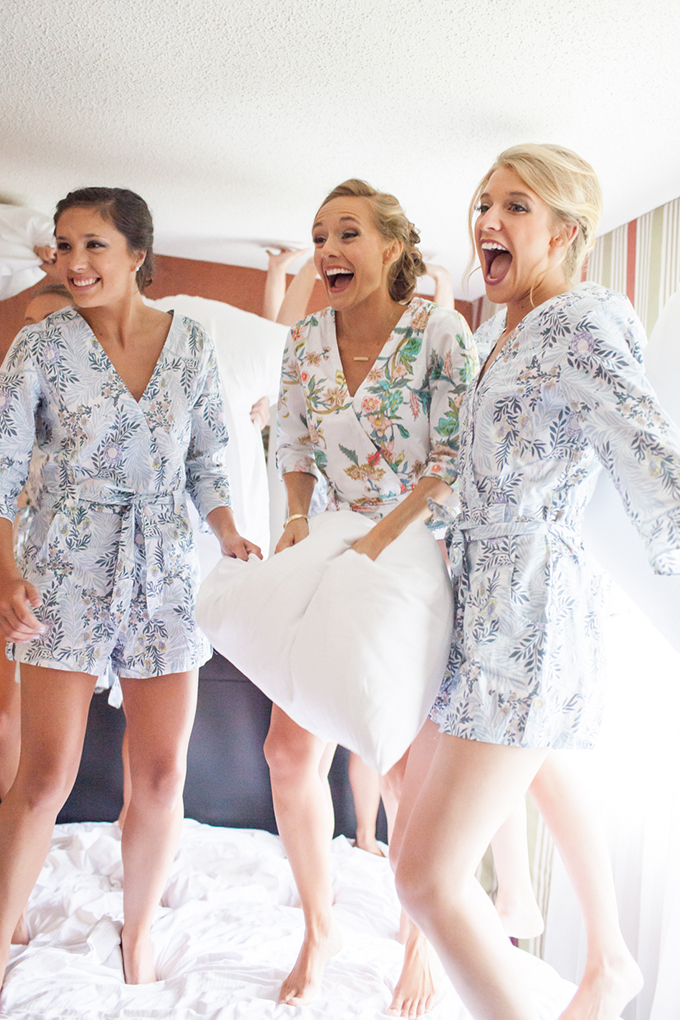 bridesmaids jumping on bed | Archetype Studio Inc. | Glamour & Grace