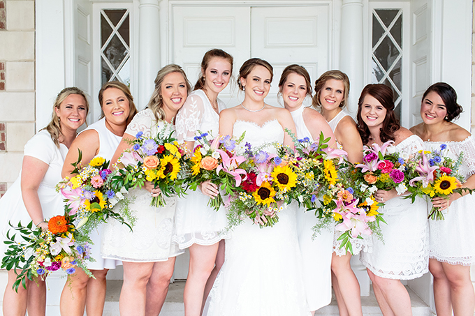 bridesmaids in white dresses with wildflower bouquets | Erin Lee Allender Photography | Glamour & Grace