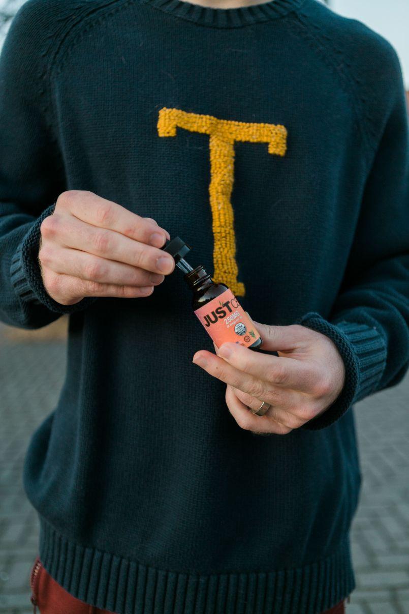 vaping a disposable CBD cartridge