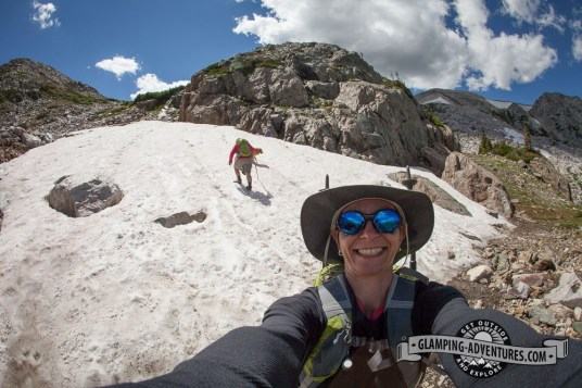 Sara climbing up the snowbank—ready for the big slide down! Medicine Bow Trail. Sugarloaf Rec. Area, WY.