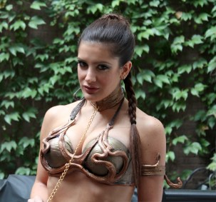 This is my Slave Leia costume from NY Comic Con 2013. I made the bra by painting it with several different metallic colors, and attached the plastic to it.