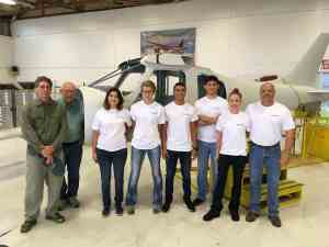 The 2017 Build-A-Plane crew. From left, Mike Baur, builder/owner Ken Baur, students Amber McCutcheon, Kodee Scott, Michael Gomez and Bryant Castro, teacher/coach Sabrina Laurent and her husband (and team chaperon) Jim Laurent. The Olney, Texas, contingent proudly wears T-shirts provided by Day One's sponsor, Garmin.