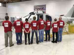 The Build-A-Plane team showing off their day's T-shirts.