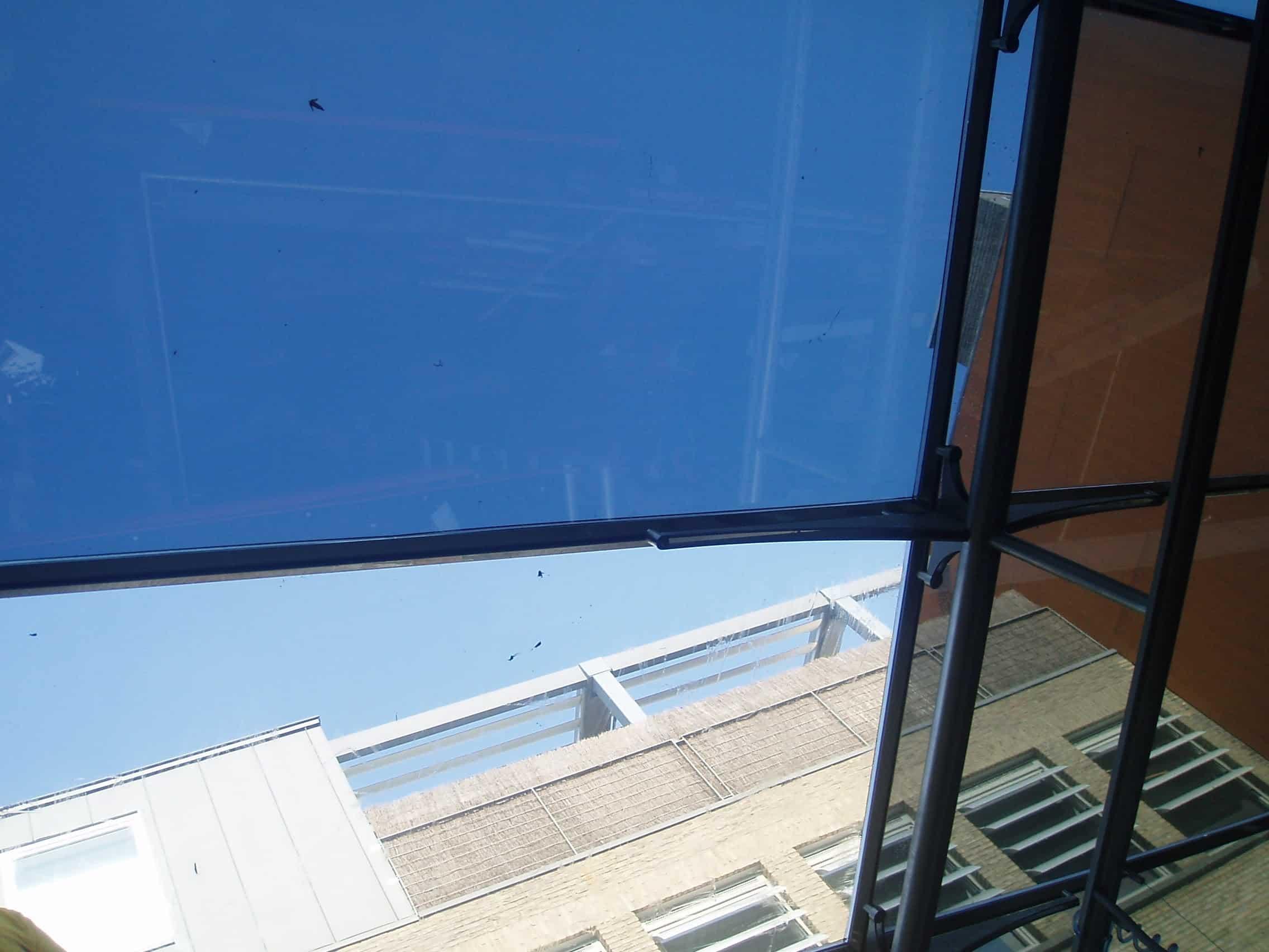 Choco Story Brugge - glazen dak van de binnenplaats voorzien van Clearview 20