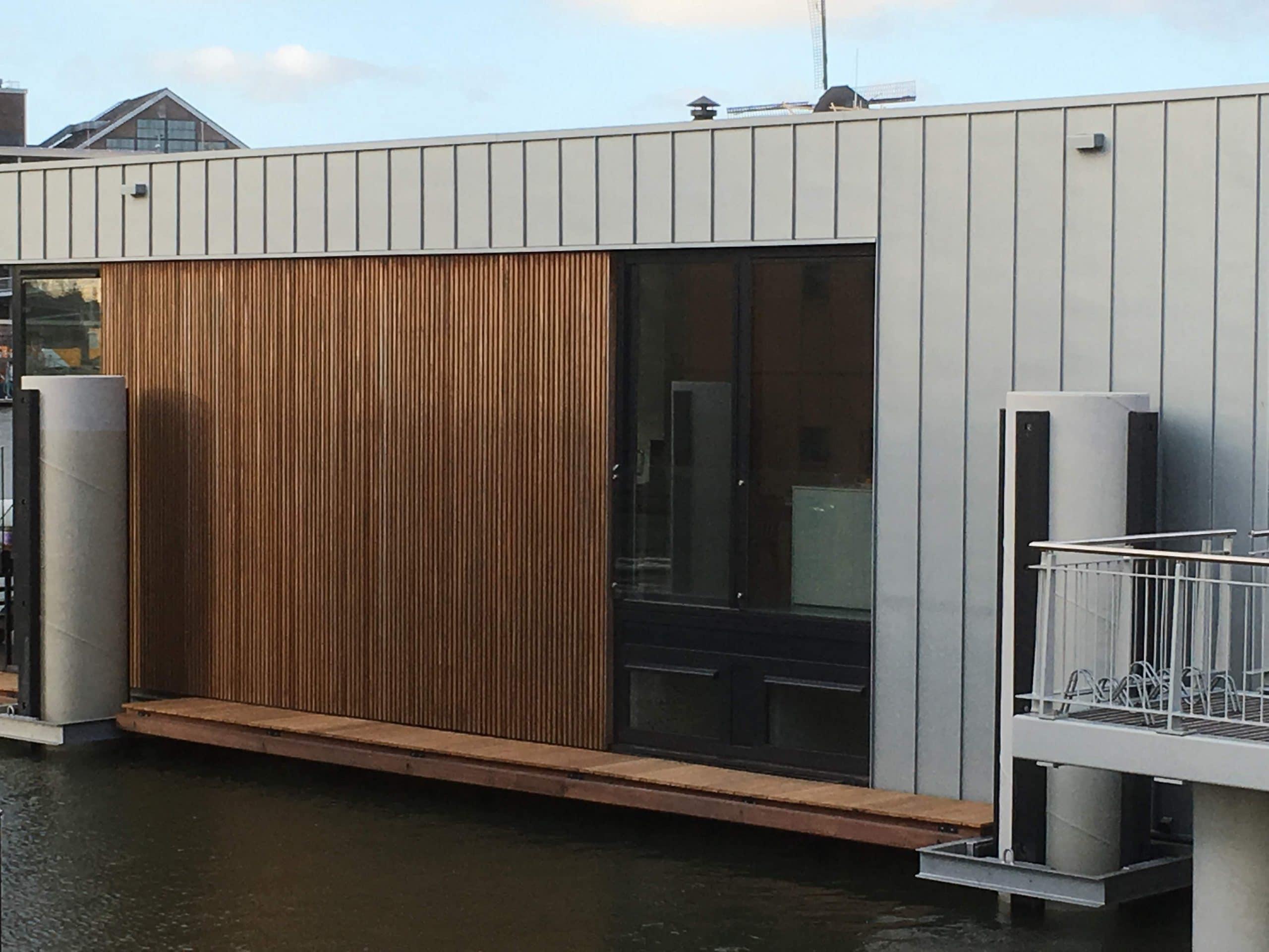 Particuliere woning voorzien van Clearview 50 teneinde zonnewarmte opwarming te reduceren