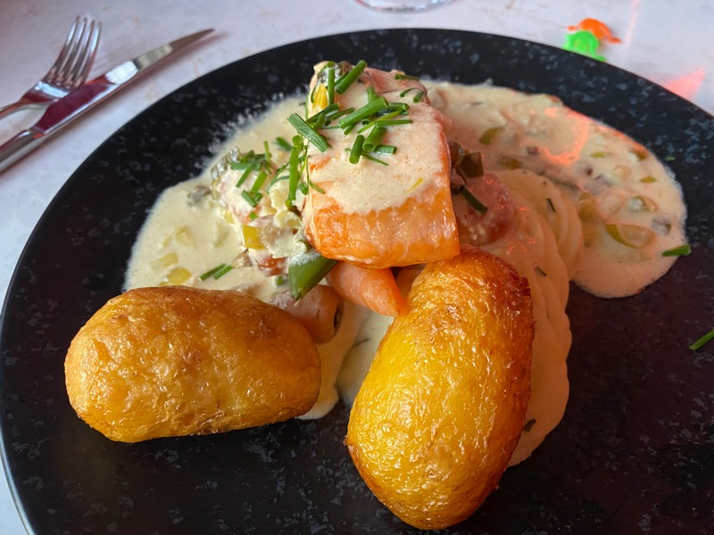 Poached fillet of salmon with cheddar and leek sauce, creamed and roast potatoes with vegetables.Dalmeny park