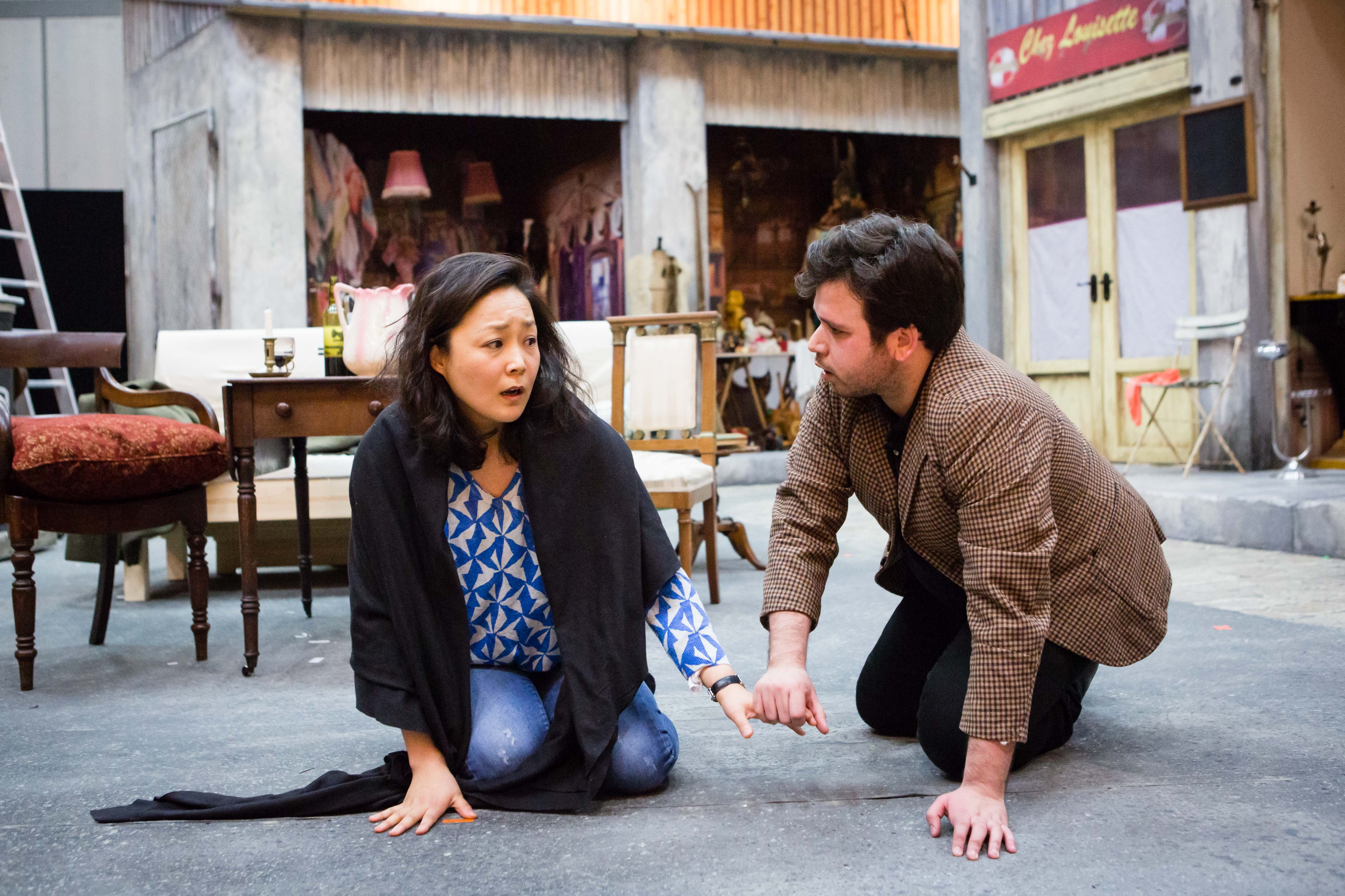 Hye-Youn Lee (Mimi) and Luis Gomes (Rodolfo) in rehearsals