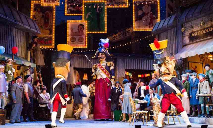 papier mache big head mannequins street scene christmas la boheme scottish opera
