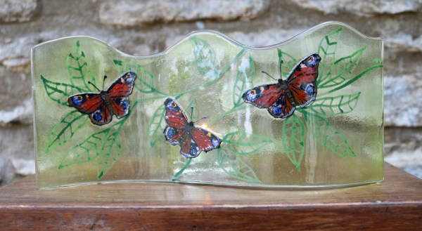 Long wavy fused glass panel with 3 Peacock butterflies