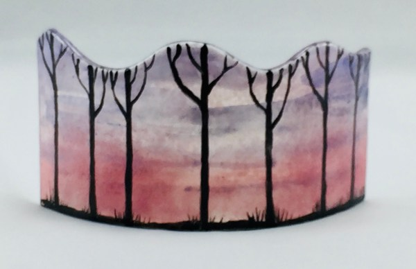 Fused glass mini panel with tree silhouettes on pinkish sunset background